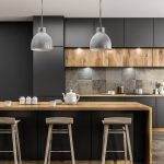 Modern kitchen interior with gray walls, tiled floor, gray countertops and wooden bar with stools in Layton, Utah